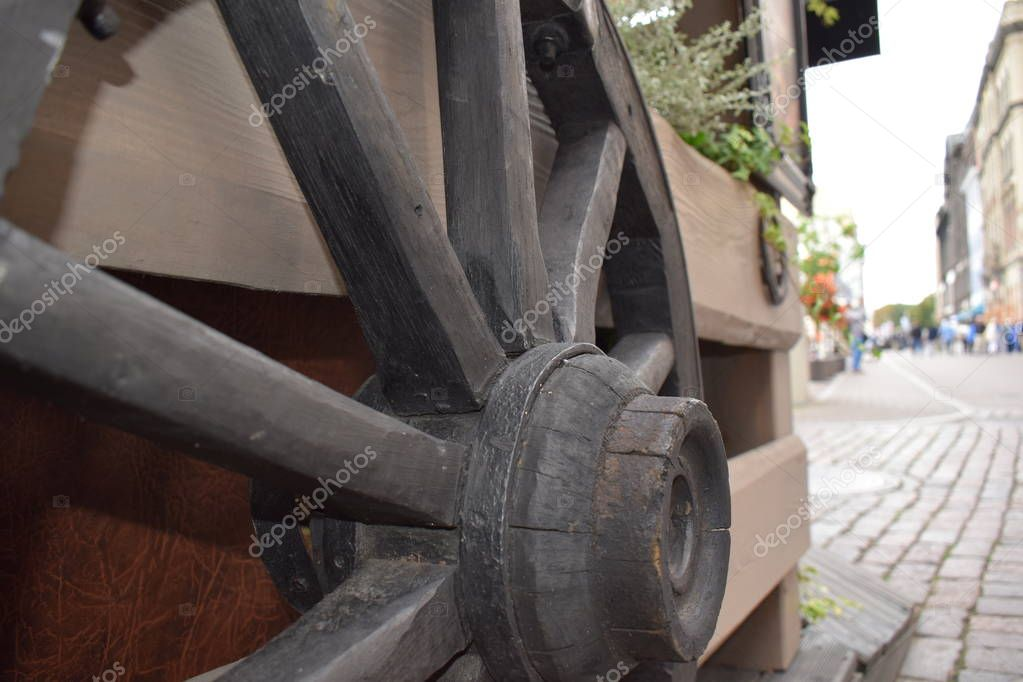 wooden wheel of carts on the fence