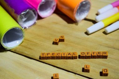 Special Offer on wooden cubes with colorful paper and pen, Concept Inspiration on Wooden background