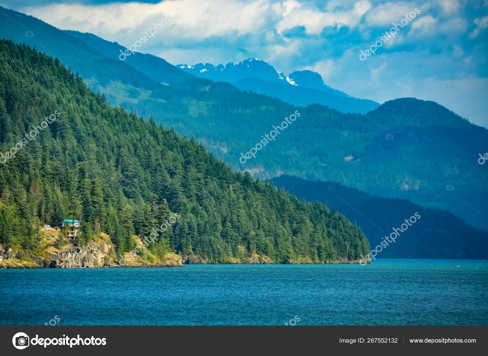 Harrison lake overview with residential house on the shore