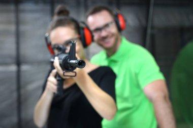 Shooting range. A woman shoots a rifle.