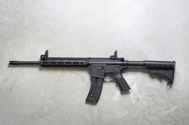 Assault rifle. Rifle on a gray background.