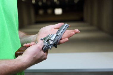 Revolver. The man is holding a revolver stock vector
