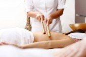 Bamboo massage. The masseur massages the body using bamboo sticks.