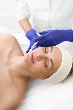 Cleavage lift. Acidic skin injection.  A patient in a cosmetic clinic, a beautician performs an injection procedure.