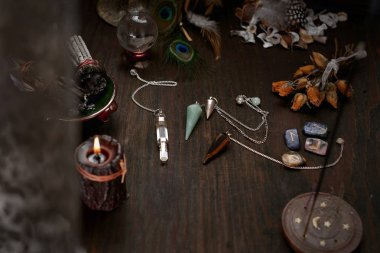Faerie accessories. A deck of old divination cards and a stone pendulum.