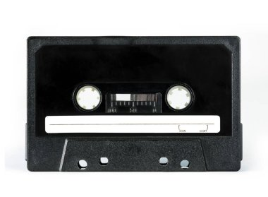 Black audio cassette for oldschool players, isolated on white background