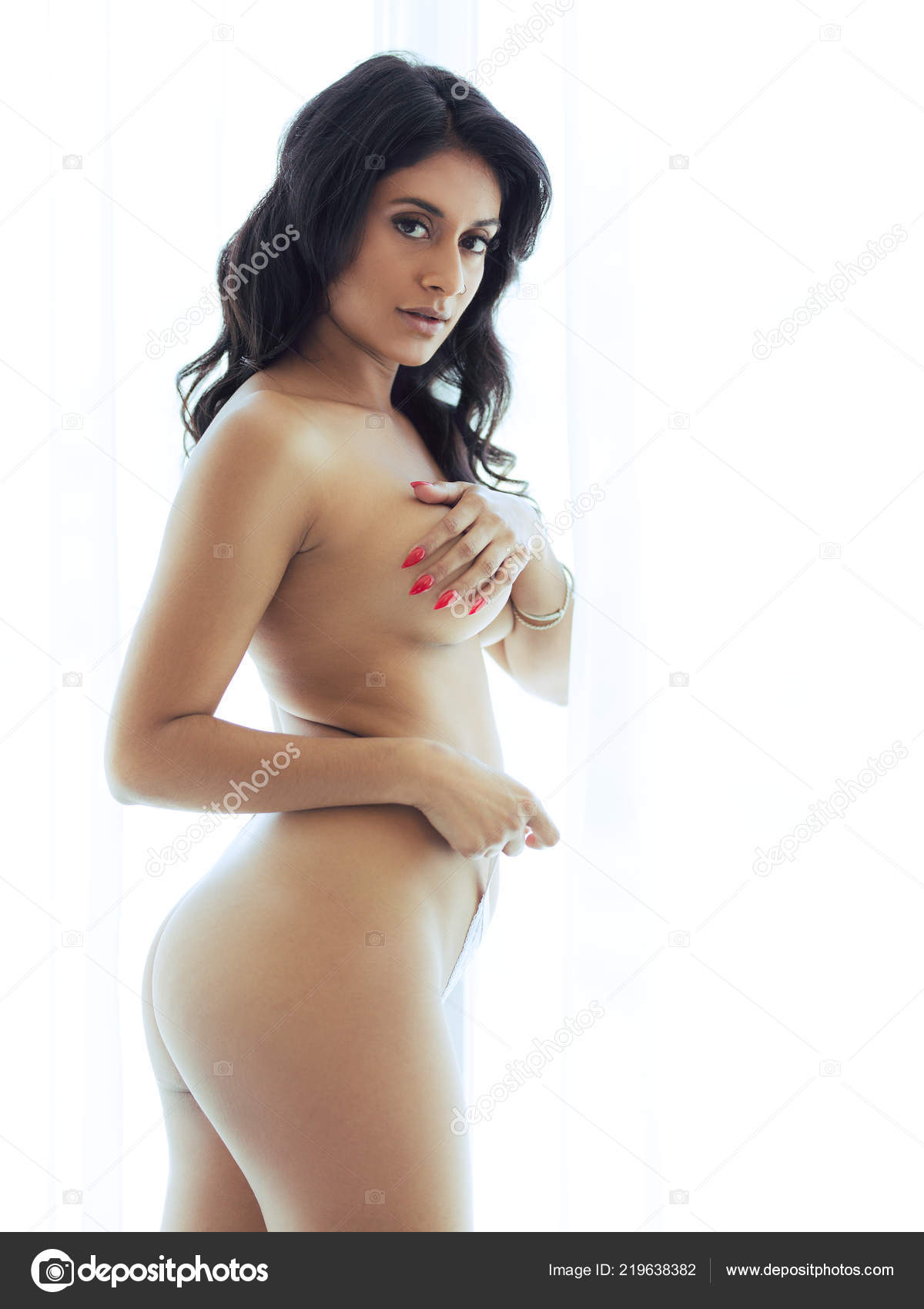 Awesome latina posing in front of a window