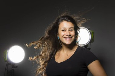 young beautiful woman posing in studio wearing casual clothes