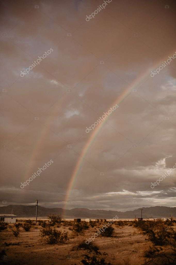 Bright rainbow in the sky with clouds