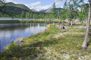 Eastern Yakutia. Summer landscape with a lake and mountains along the banks.