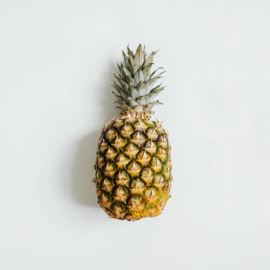 Ripe pineapple on white background isolated. Minimalist style trendy tropical concept.