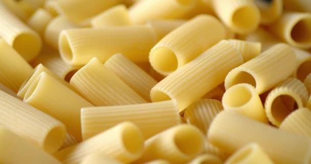 Italian cannelloni pasta dry on the table slowly rotates.