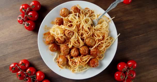 Ready meatballs with spaghetti slowly rotated.