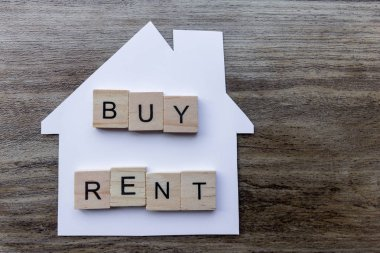 Housing Market Concept - Paper house with the words 'Buy, Rent'