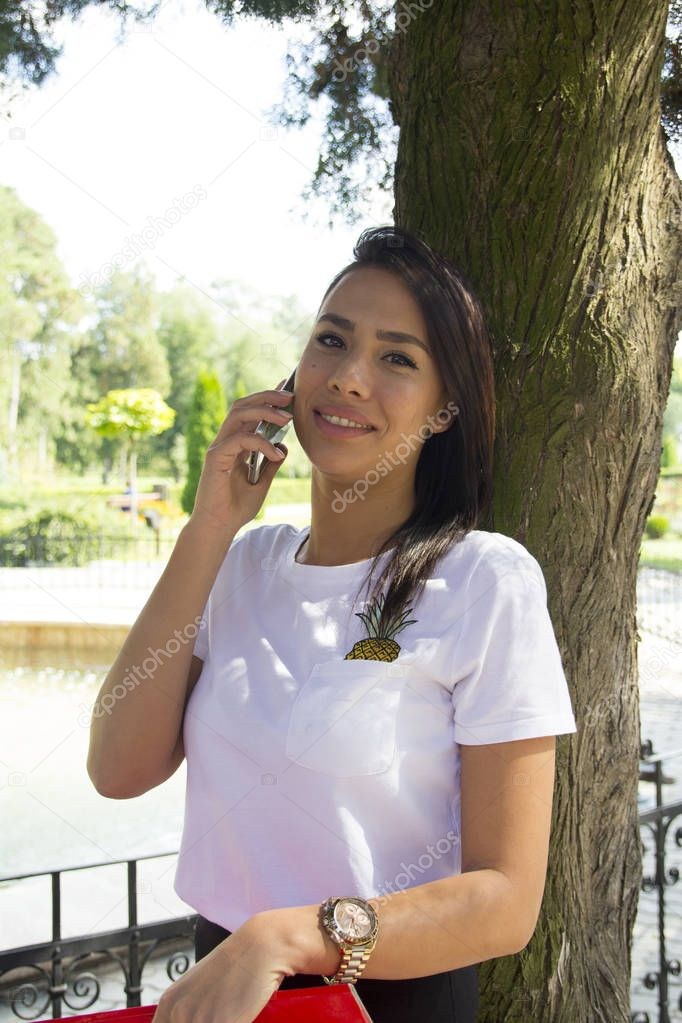 Young woman phoning with a mobile phone, Selective focus and small depth of field
