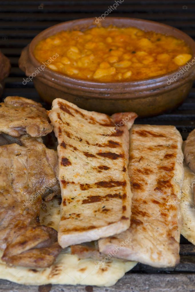 Very tasty pork meat grilled and baked beans in an earthenware