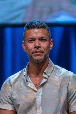 Bonn, Germany - June 8 2019: Wilson Cruz (*1973, American actor - Star Trek: Discovery) speaking at FedCon 28, a four day sci-fi convention. FedCon 28 took place Jun 7-10 2019.