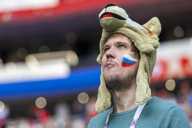 Russia - June, 2018: Male Russian football fans supporting teams on stadium