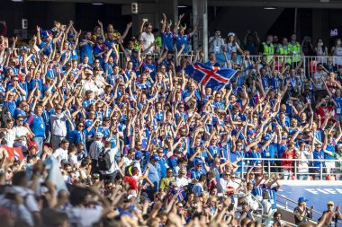 Russia - June, 2018: Football fans supporting teams on street of city