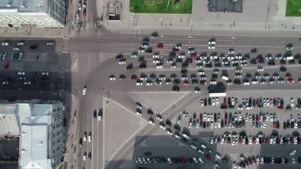 Aerial top view car free parking space. Aerial view from above flying drone cars moving and standing on parking lot in modern city. Car traffic and parking concept. City filled with cars, city ecology