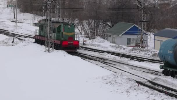 Ufa, Russia, 16 February 2020: An old Soviet diesel locomotive at a railway station maneuvers between tracks