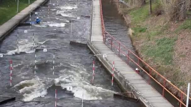 Kayak training, Kayak Race near the bridge where water strong whirlpools arise near the piles
