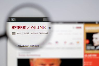 New York, USA - March 26, 2019: Germany news media Spiegel Online website homepage. Spiegel Online logo visible  through a magnifying glass.
