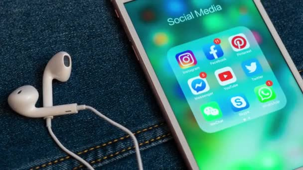 Tallinn/Estonia- May 19, 2019: White Apple iPhone with icons of social media: instagram, youtube, facebook, twitter, skype, whatsapp applications on screen. Social media icons.