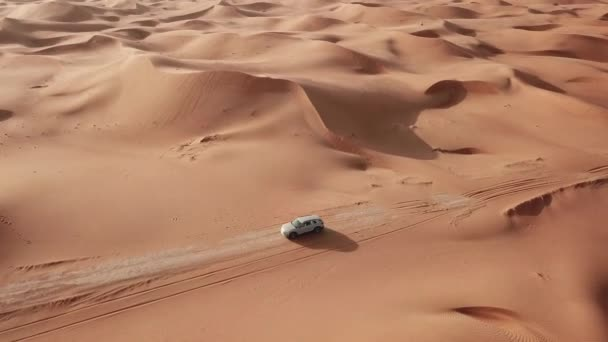 4K Aerial view following new e-tron in the desert of Abu dhabi. U.A.E. Electric car in desert