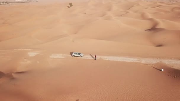 4K Aerial view following new e-tron in the desert of Abu dhabi. U.A.E. Electric car in desert