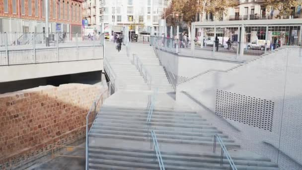 A man descends the stairs to an underground shop