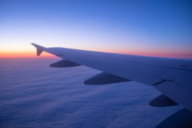 Aircraft wind on the sunrise sky background. Composition of aircraft