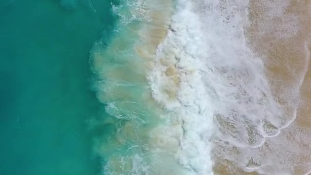 Coast as a background from top view. Turquoise water background from top view. Summer seascape from air. Nusa Penida island, Indonesia. Travel - video