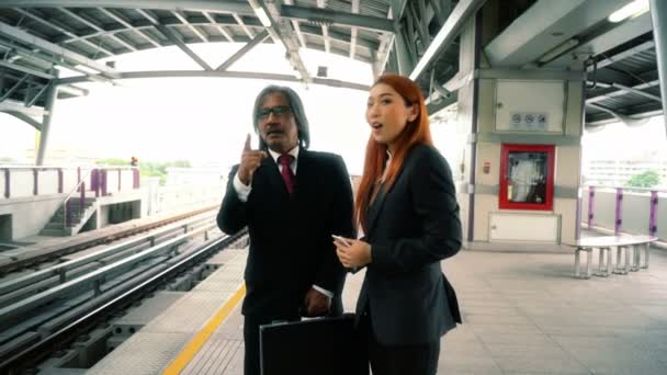 Business man and woman are talking about their project while waiting for the train