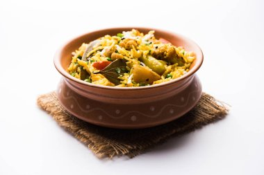 Masala Rice or masale bhat - is a spicy vegetable fried rice / biryani or Pulav usually made during wedding occasions in maharashtra, India stock vector