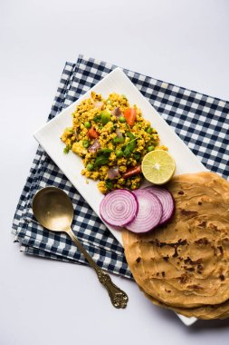 Paneer Bhurji, mildly spiced cottage cheese scramble and served with roti or laccha paratha, selective focus