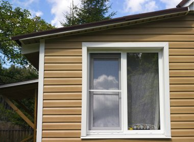 Cropped shot of an old house with new pvc window, outside shot