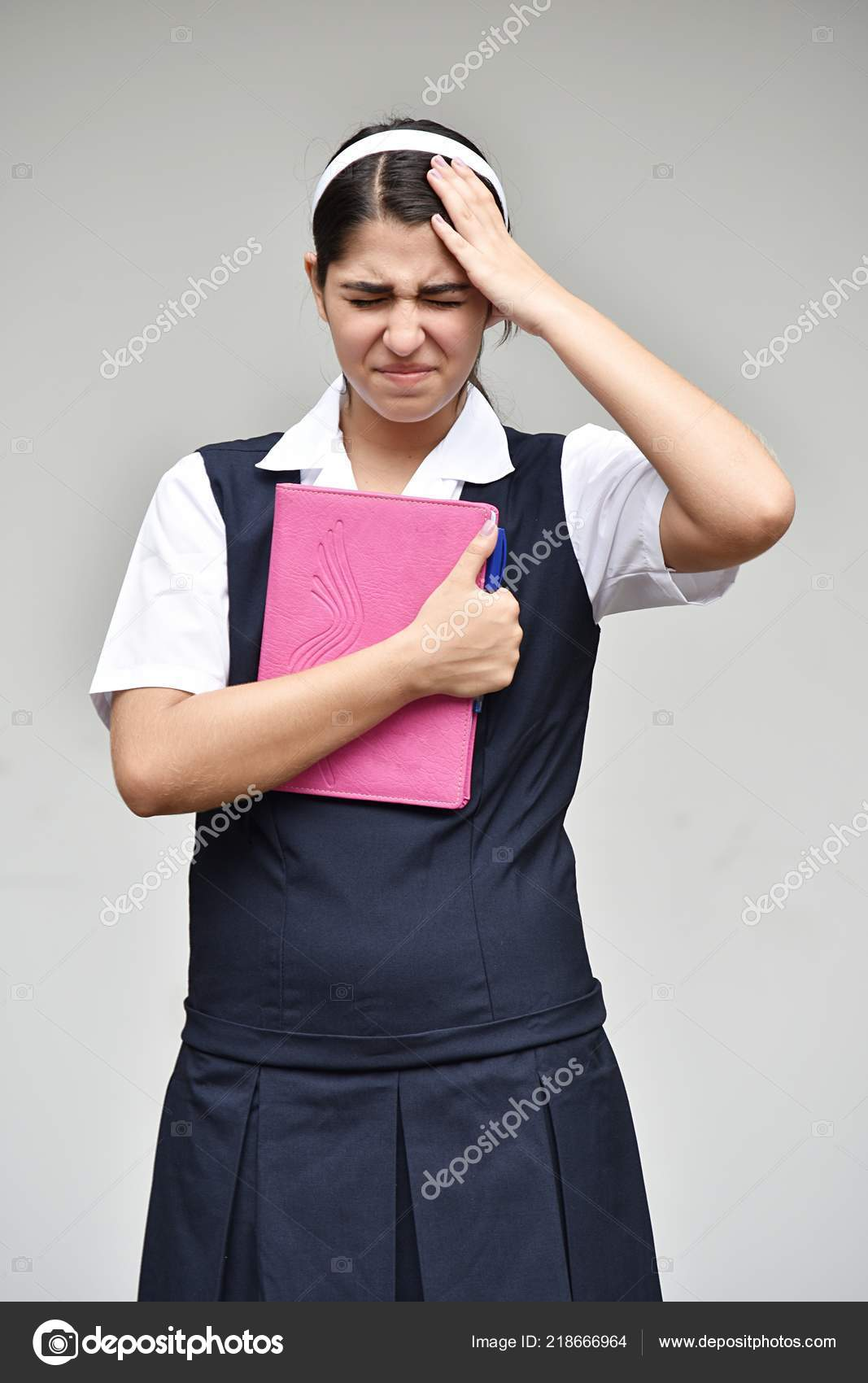 stressed catholic colombian person notebook stock photo dtiberio