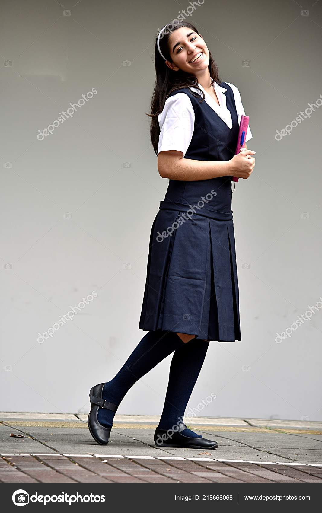posing cute colombian school girl stock photo dtiberio 218668068