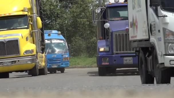Trucks Driving On Rural Road