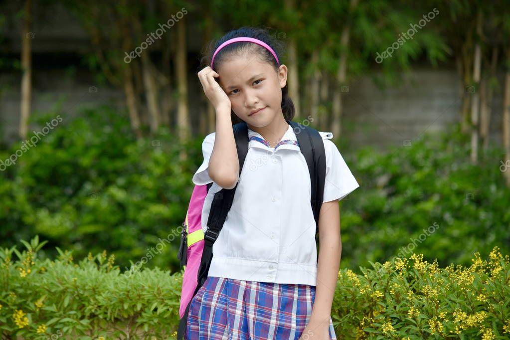 Worrisome Girl Student Wearing School Uniform With Books