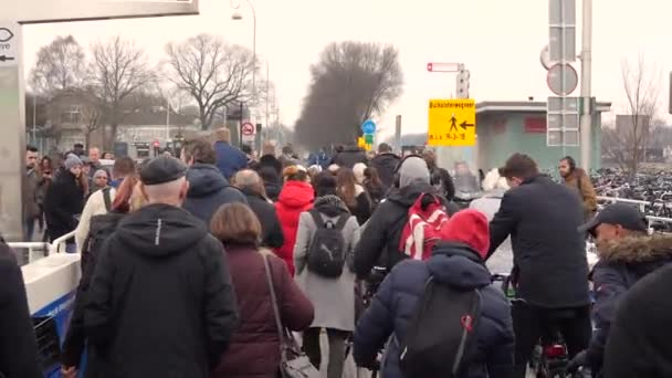Footage of people getting out from passenger ferry in Amsterdam city, Holland.