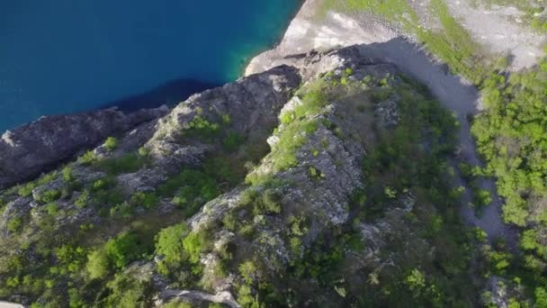 Aerial footage of amazingly clean blue lake.  Amazing view of small beach and clean lake. Destination travel.