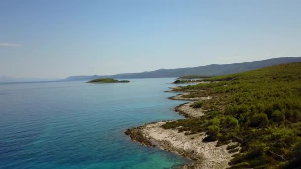 Drone footage. Flying over clean coast and amazing blue sea. Aerial view of horizon.