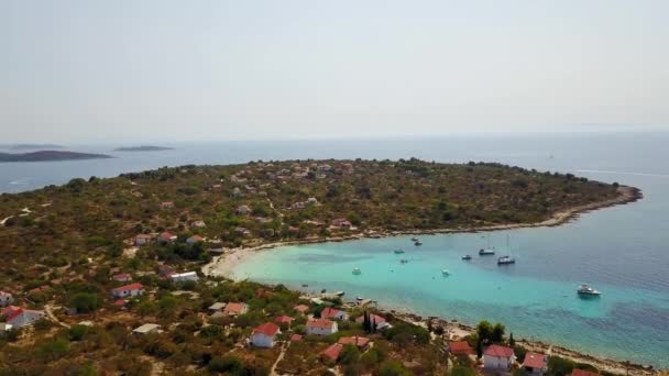 Amazing aerial footage of blue bay, sand beach and boats at anchor. Holiday paradise.