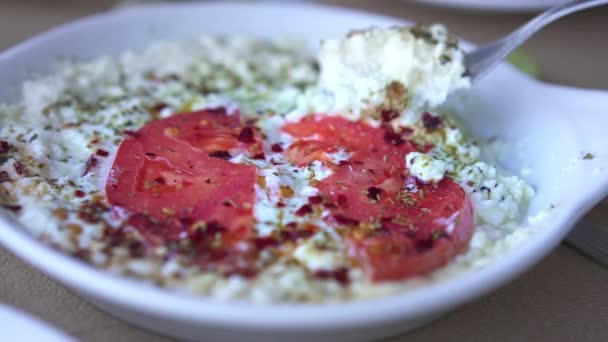Eating Greek Feta with Tomatoes, Slow Motion video, close up shot
