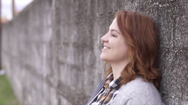 Woman with great smile, outdoors, shallow depth of field slow motion video, shot with gimbal