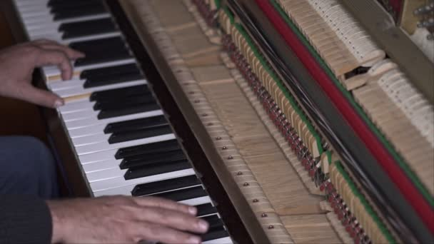 Musician plays open piano, Slow Motion Top View Medium shot with shallow depth of field