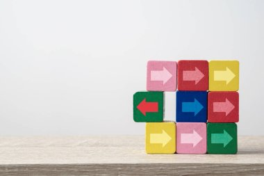 Think outside the box, stand out concept with arrows on wooden blocks. Business background