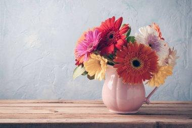 Gerbera daisy flower boquet on wooden table background